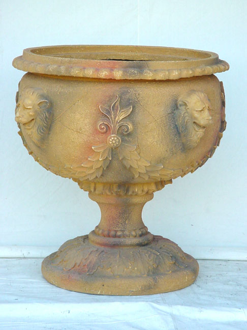 VASE WITH FOUR HEAD LEO SANDSTONE 1